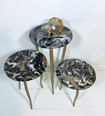 picture of acrylic paint poured nesting tables.