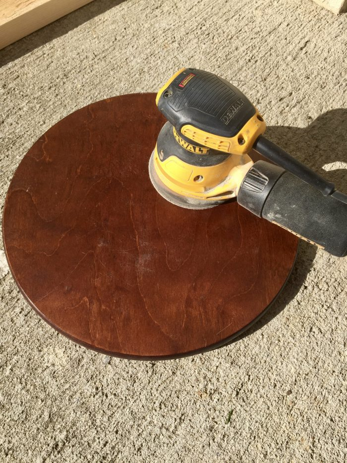 sanding with orbital sander before acrylic paint pour.