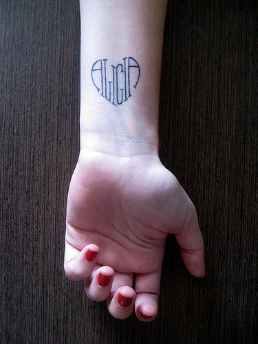 Heart shape tattoo design with name Alicia