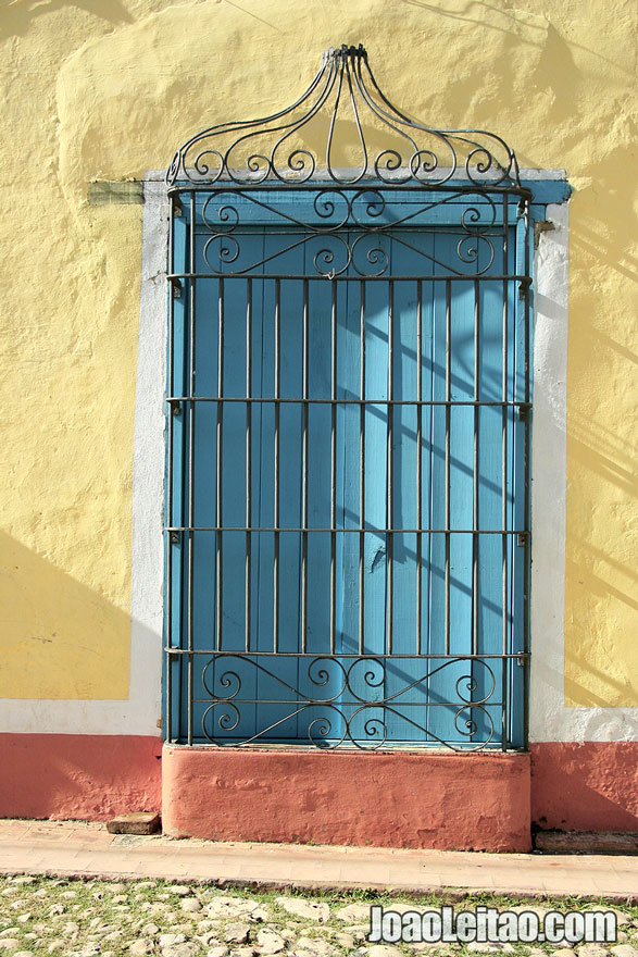 Blue window and yellow building in Trinidad