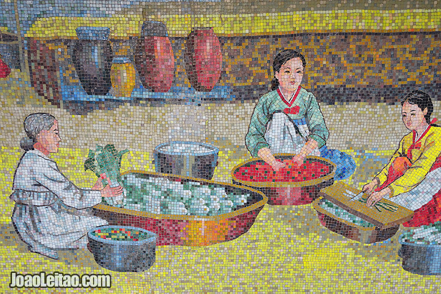 Mosaics depicting Korean traditional life, with women cooking vegetables. This set of mosaics can be found at the Sariwon City Fold Museum.