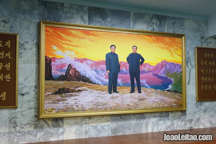 This is a famous painting of the leaders North Korea, Kim Il-sung and Kim Jong-il