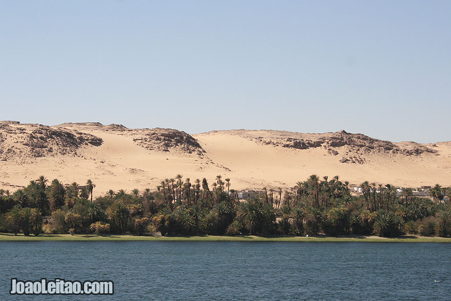 Dunes and The Nile river just before arriving in Luxor