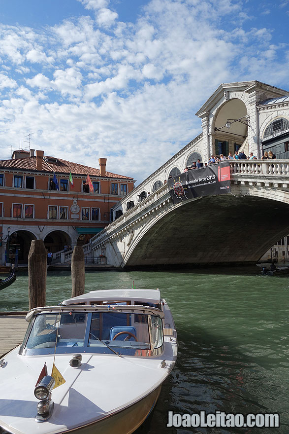 Boat taxi and the Rialto Bridge or Ponte di Rialto spanning the Grand Canal in Venice