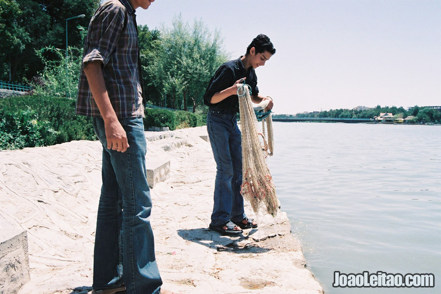 Boys fishing in River Zayandeh in Isfahan