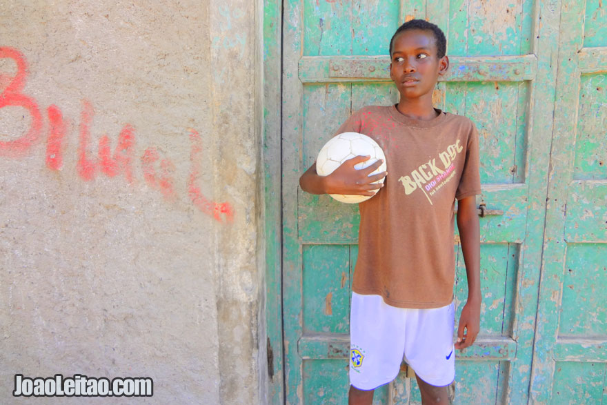 Kid with football in Berbera coastal city in the Gulf of Aden