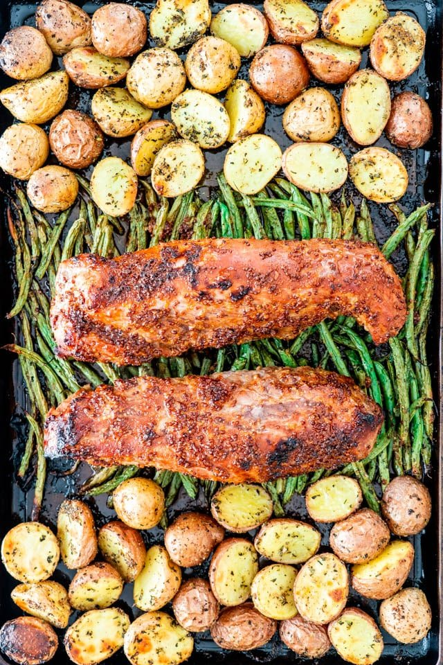 Honey Mustard Pork Tenderloin on a baking sheet with roasted potatoes and green beans