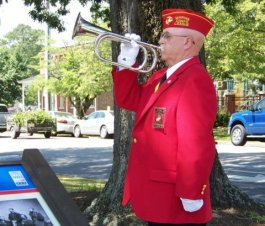 Ken Parker with the Marine Corps League Detachment 1236, and a Vietnam Veteran, plays Taps during the Memorial Day Ceremony.