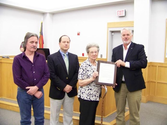 (Caption) Smithfield Mayor John Lampe (far right) presents a proclamation remembering the legacy of former Mayor Norwood Worley to his family including his wife, Jean, and two sons, Earl and Paul.