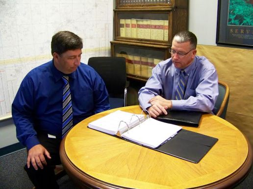 Johnston County Manager Rick Hester (far right) and Assistant County Manager and Finance Director Chad McLamb review the proposed 2016-17 fiscal year budget. JoCoReport.com Photo