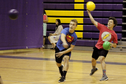 Superhero Squad team members Erik Oehler (left) and Ryan Stein (right) give it their all during the Corinth Holders High FCA Dodgeball Tournament.