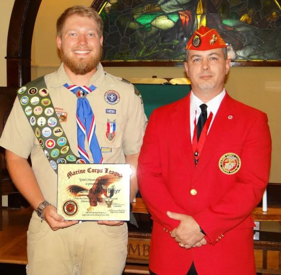 "(Left to right) William ""Kyle"" Walker of Boy Scout Troop 210 of McGee's Crossroads receives the Eagle Scout Good Citizenship Award from Lewis W. Rice III from the Johnston County Marine Corps League Carry-On Detachment."