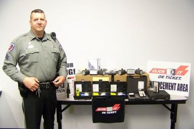 Sgt. T.L. Avery stands with $9,000 worth of equipment received this week by the Selma Police from the Governors Highway Safety Program. JoCoReport.com Photo