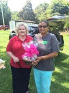 (Left to right) Jenny Campbell of Jenny's Sweet Creations recognizes Cleo McKinnon, founder of the Community Court in Benson, with a gift basket for receiving July's Town of Benson Caught Ya Doing Good! Award.