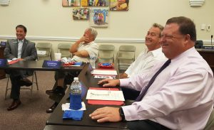 (Right to left) Superintendent Dr. Ross Renfrow, Clayton Mayor Jody L.  McLeod, Four Oaks Mayor Linwood Parker, and Smithfield Mayor Andy Moore discuss the future of Johnston County Schools last Thursday at the Johnston County Board of Education Building.