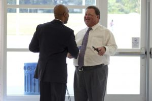 Cleveland High Principal Kendrick Byrd (left) welcomes JCS Superintendent Dr. Ross Renfrow (right) to his school Monday, Aug. 29.