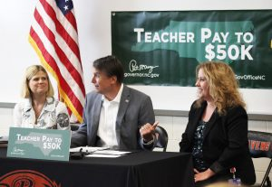 NC Governor Pat McCrory (center) conducts a press conference with Riverwood Middle Principal Kerri Evans and Catherine Truitt, Senior Education Advisor for the Office of the Governor.