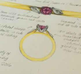 Sarah's leaf inspired ring with diamond set leaves on the shoulders