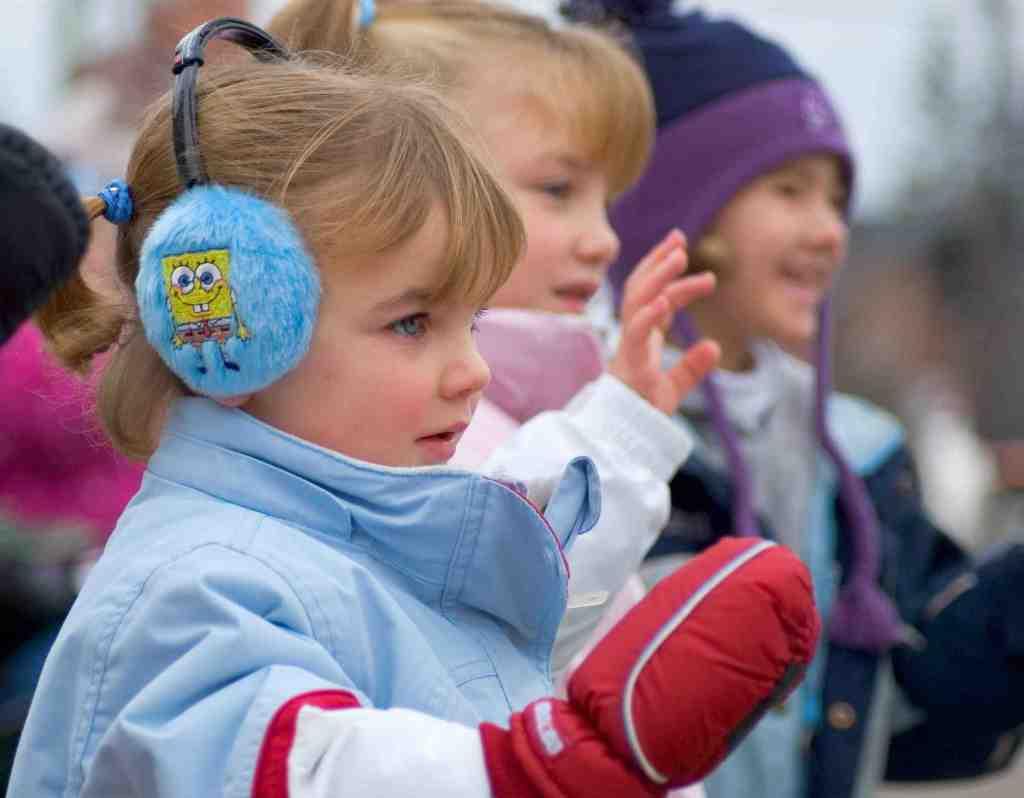 children waving winter parade