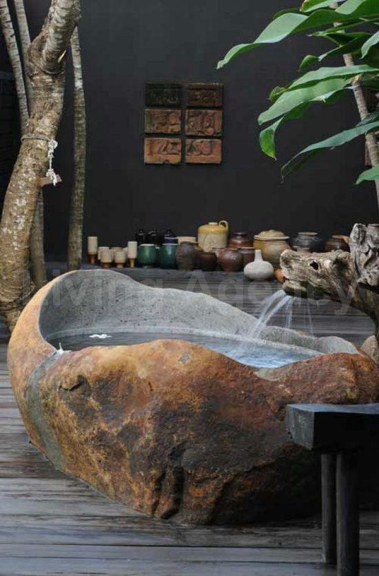 hollowed rock bathtub