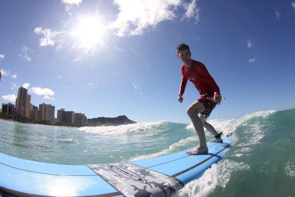 Man on surf board hang ten