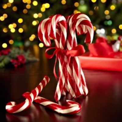 candy canes in front of a christmas tree
