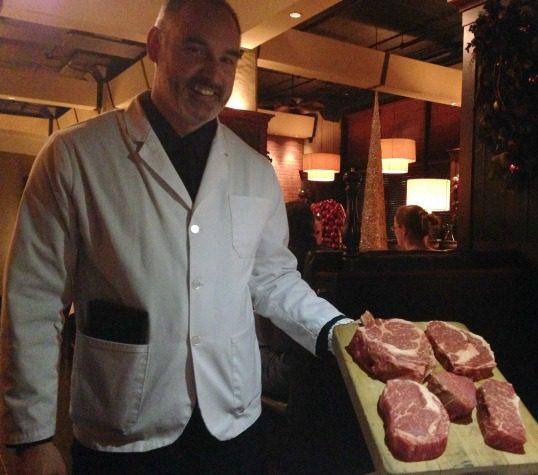 Waiter with steak board