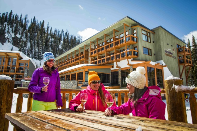 women drinking white wine at outdoor patio in winter