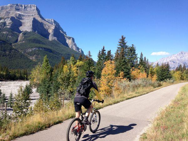 man riding paved mountain bike trail
