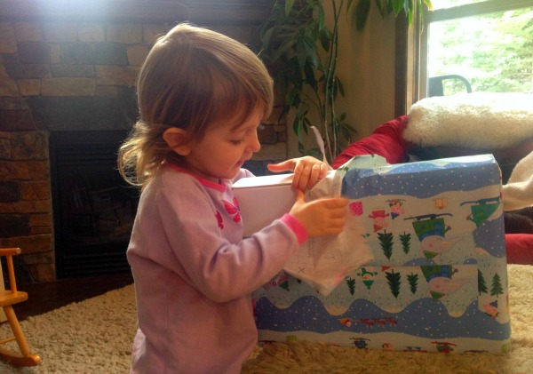 girl unwrapping present