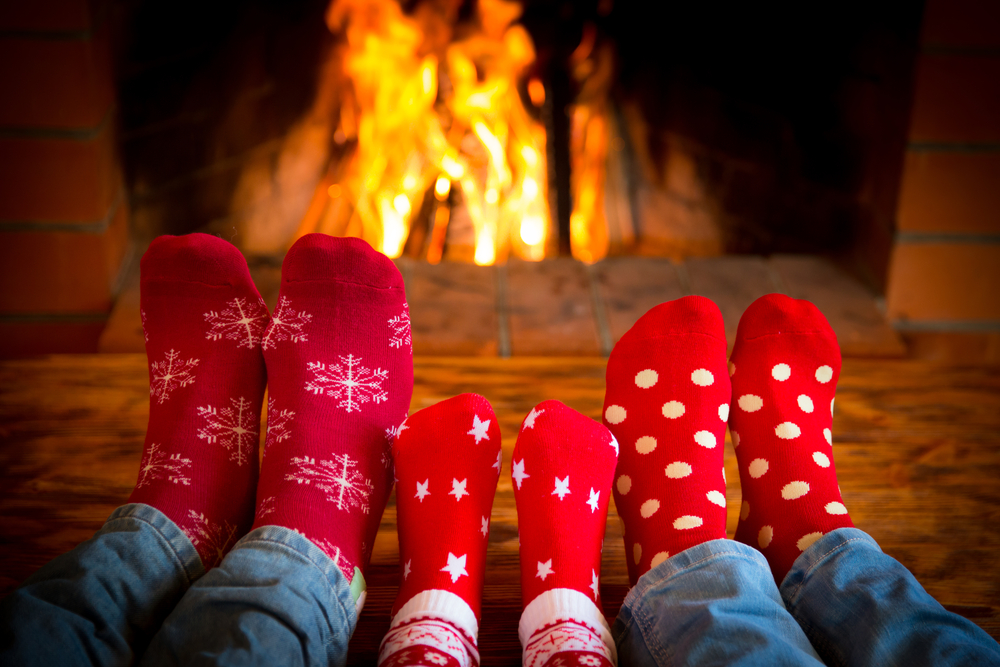family feet up by the fire