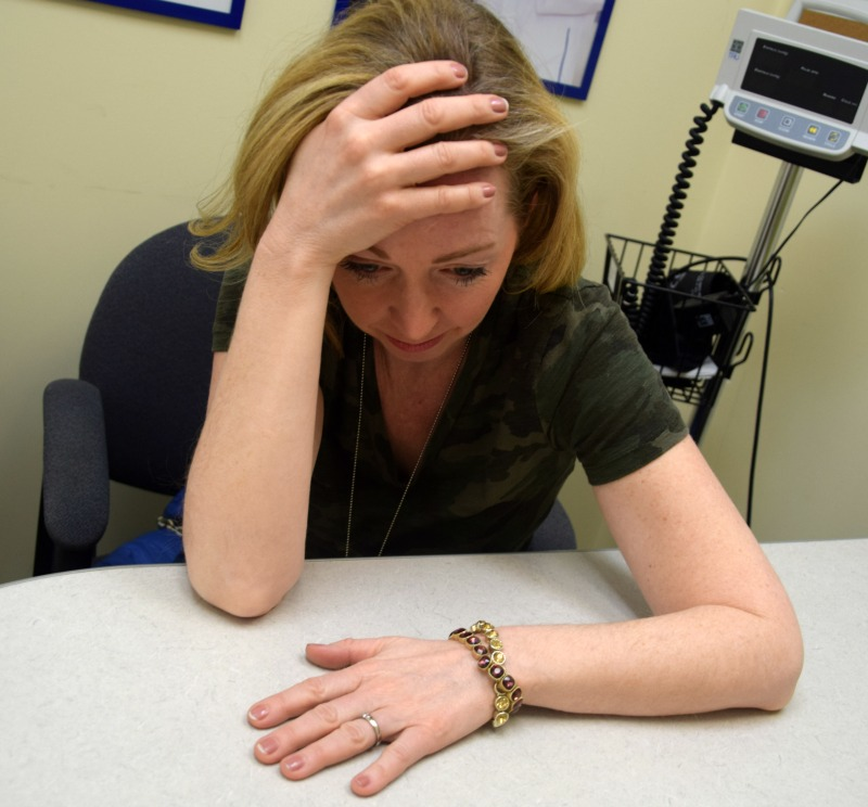woman stressed in doctor's office