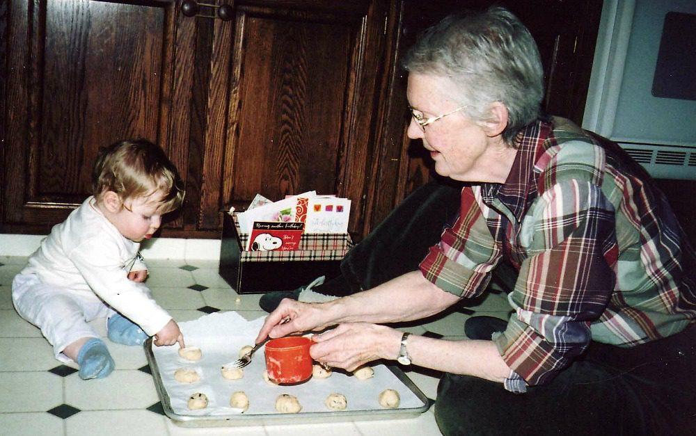 baby helping make cookies
