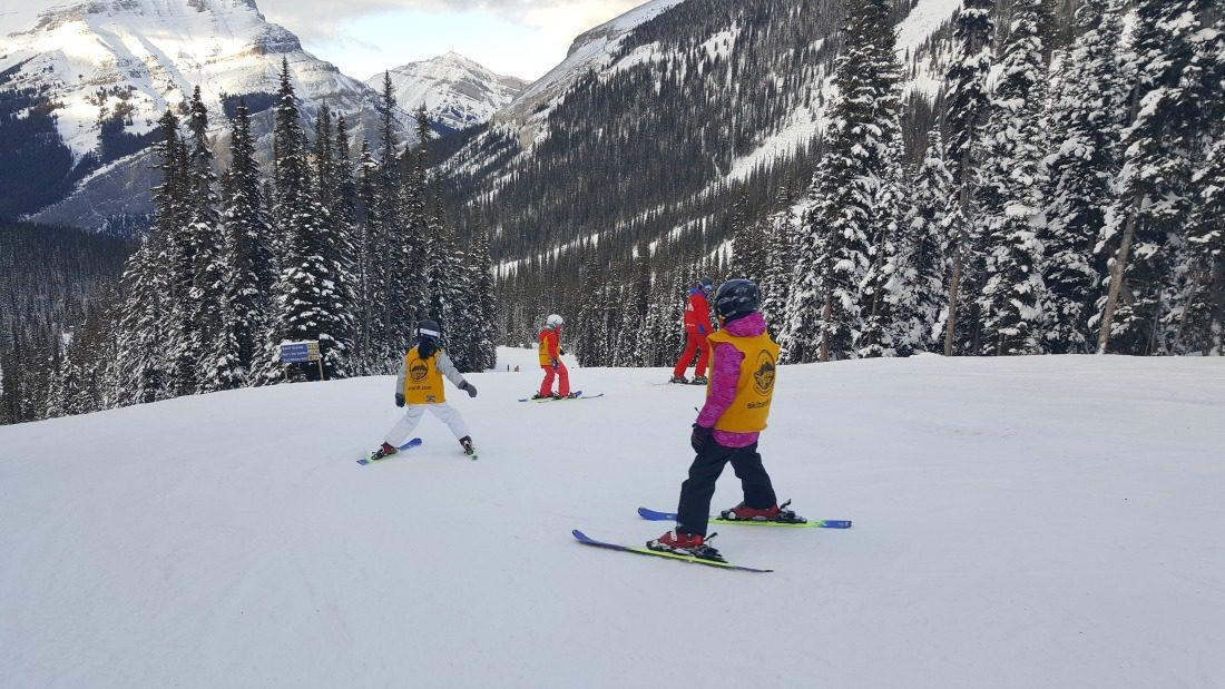 kids snowplowing on skis