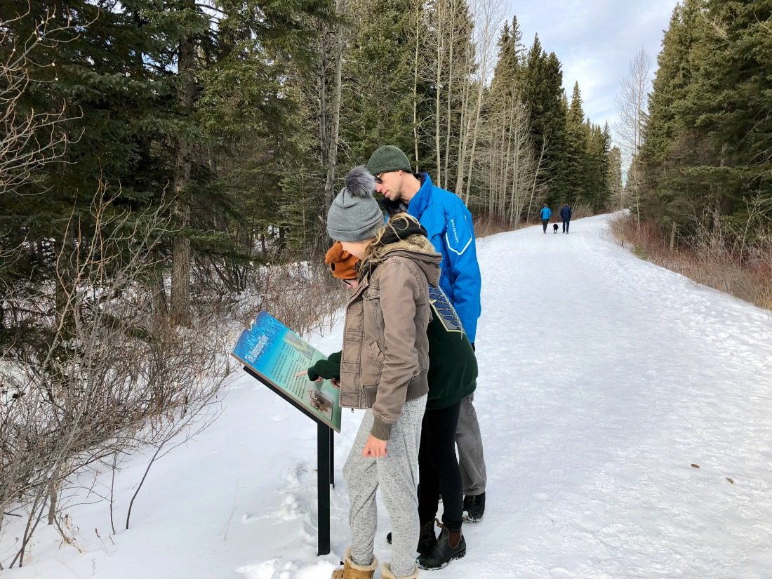 family on river trail rockies
