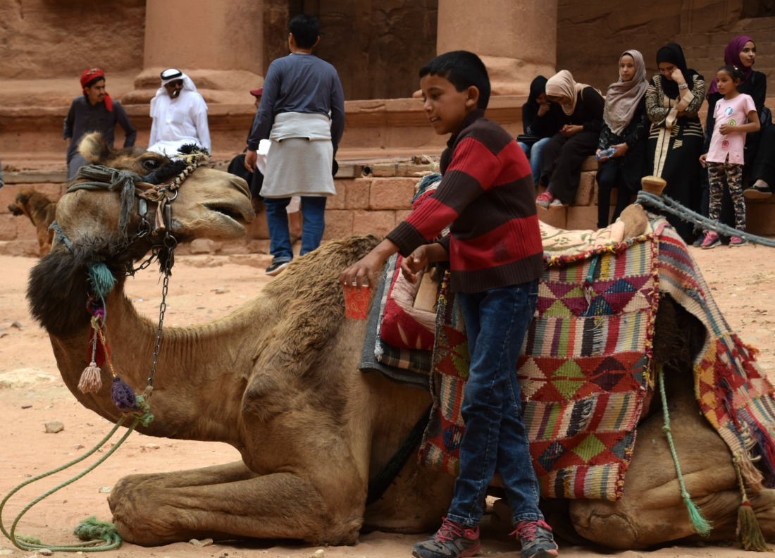 boy and camel Petra treasury
