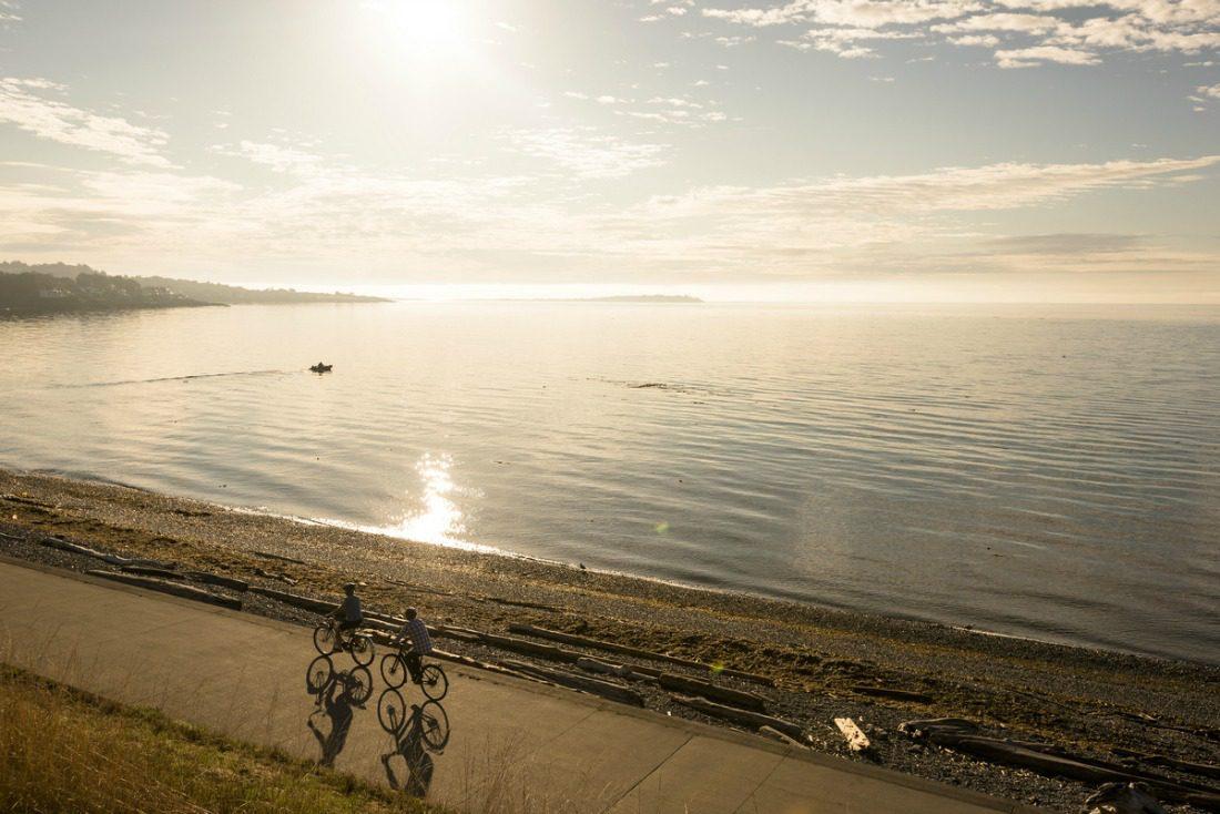 biking along the ocean at sunset