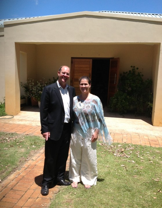 Pastor and Mrs. Jason Labuschagne in front of Plumstead Baptist Church