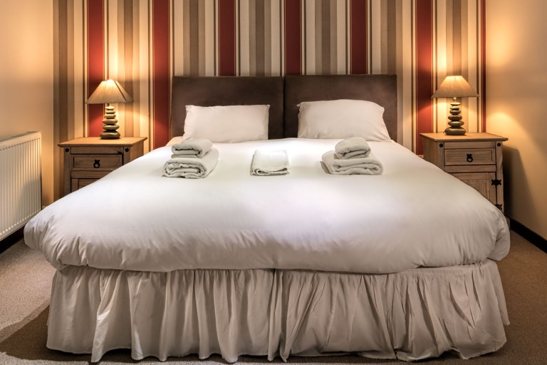 Hotel or B & B accommodation photography sample bed image