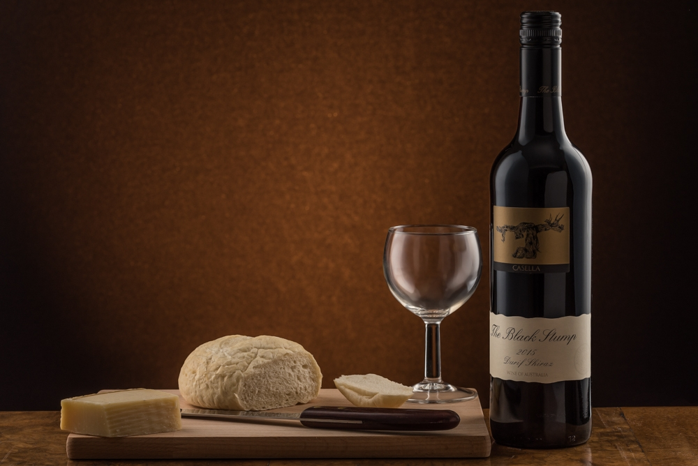 Wine Photography - Red Wine Bottle-3 Black Stump with bread and cheese