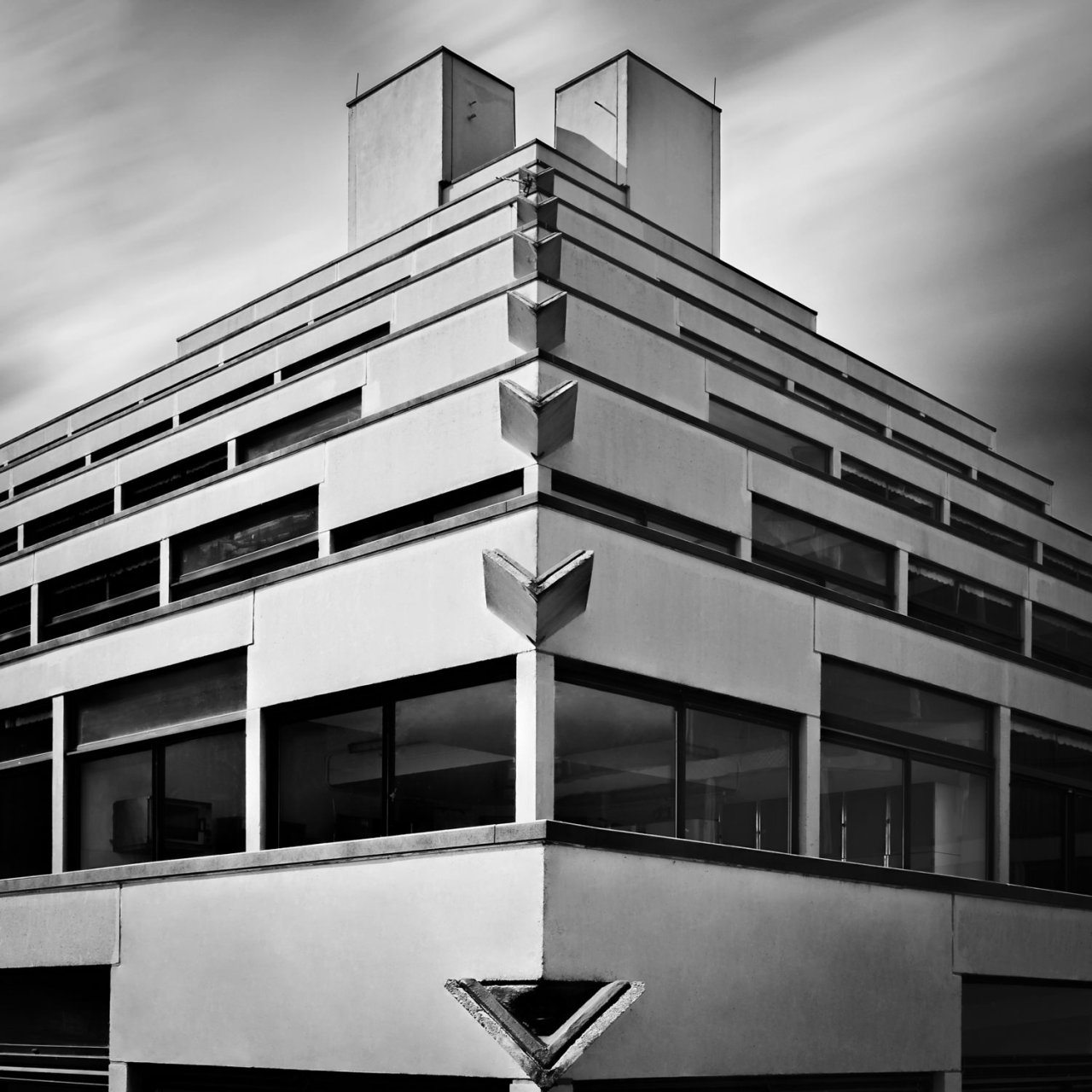 Close up architectural monochrome image of UEA Ziggurat
