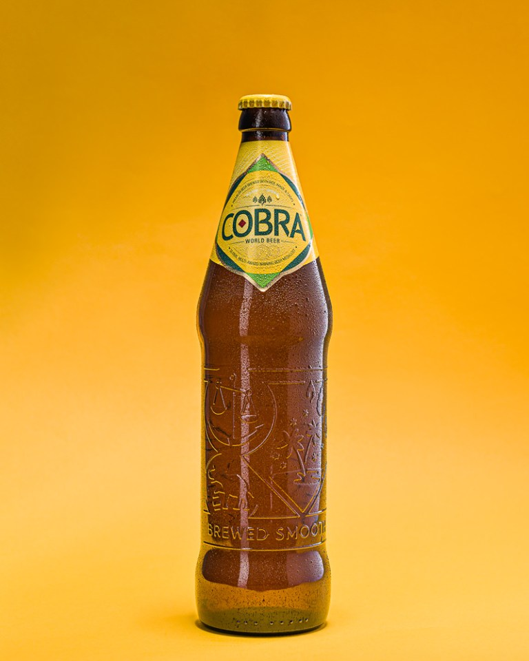 Bottle of Cobra Beer on Yellow Background