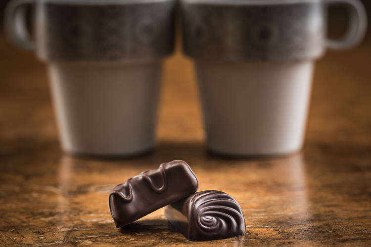 Creative Chocolate Photography - chocolates with coffee cups
