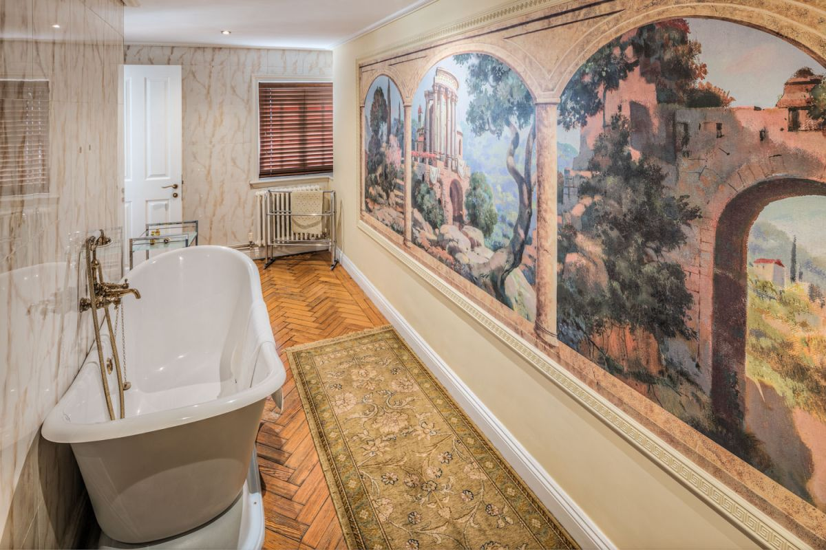 Luxury hotel bathroom with mural painted on wall