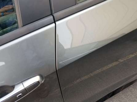 """Scratch in the driver side rear door (this explains the """"thump"""" I heard behind me)."""