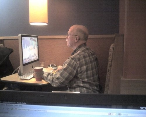 Man brings his iMac to Panera Bread.