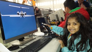 """Lily really enjoyed """"flying"""" an airplane"""