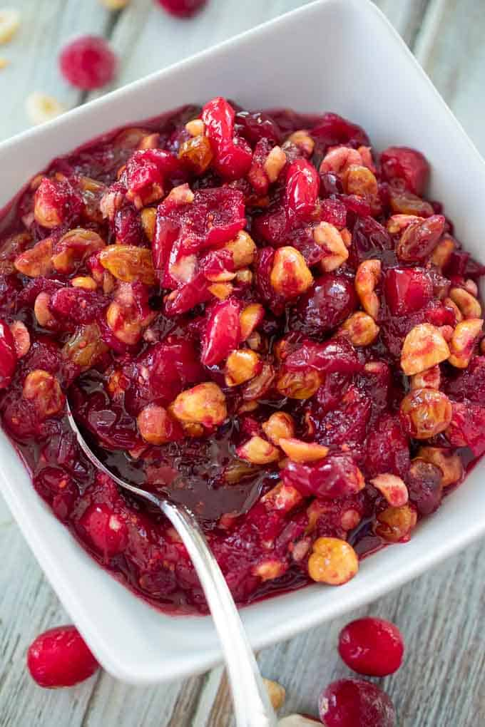 Bowl of homemade cranberry sauce with hazelnuts
