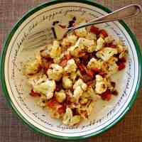 Pan seared cauliflower with bacon and garlic