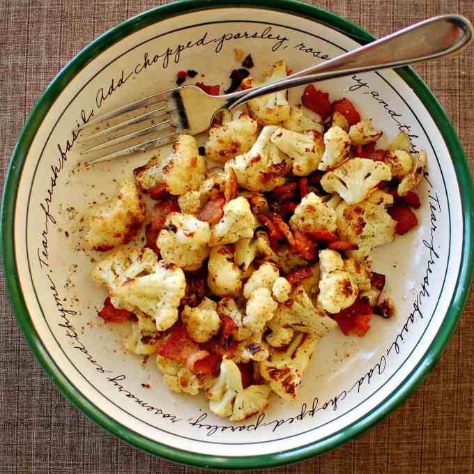 Pan seared cauliflower with bacon and garlic. Wonderful side dish to have with chicken or a small steak. Enjoy! | joeshealthymeals.com